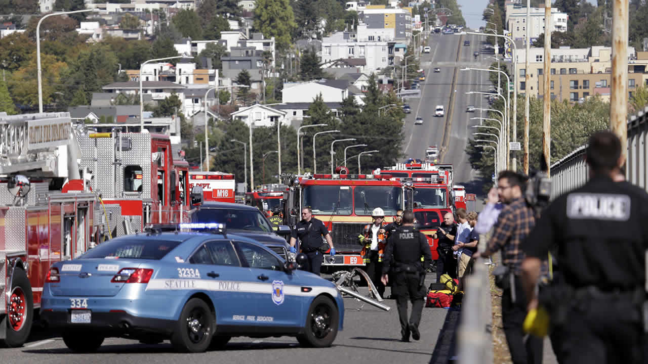 Emergency vehicles surround the site of a deadly crash between a charter bus and an amphibious tour vehicle in Seattle on Thursday, Sept. 24, 2015. (AP Photo/Elaine Thompson)