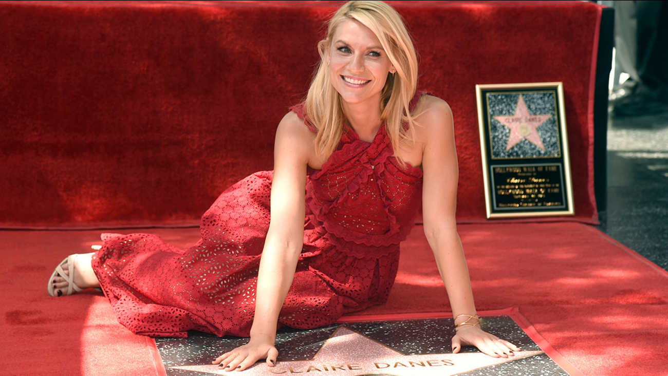 Claire Danes poses atop her new star on the Hollywood Walk of Fame on Thursday, Sept. 24, 2015, in Los Angeles.