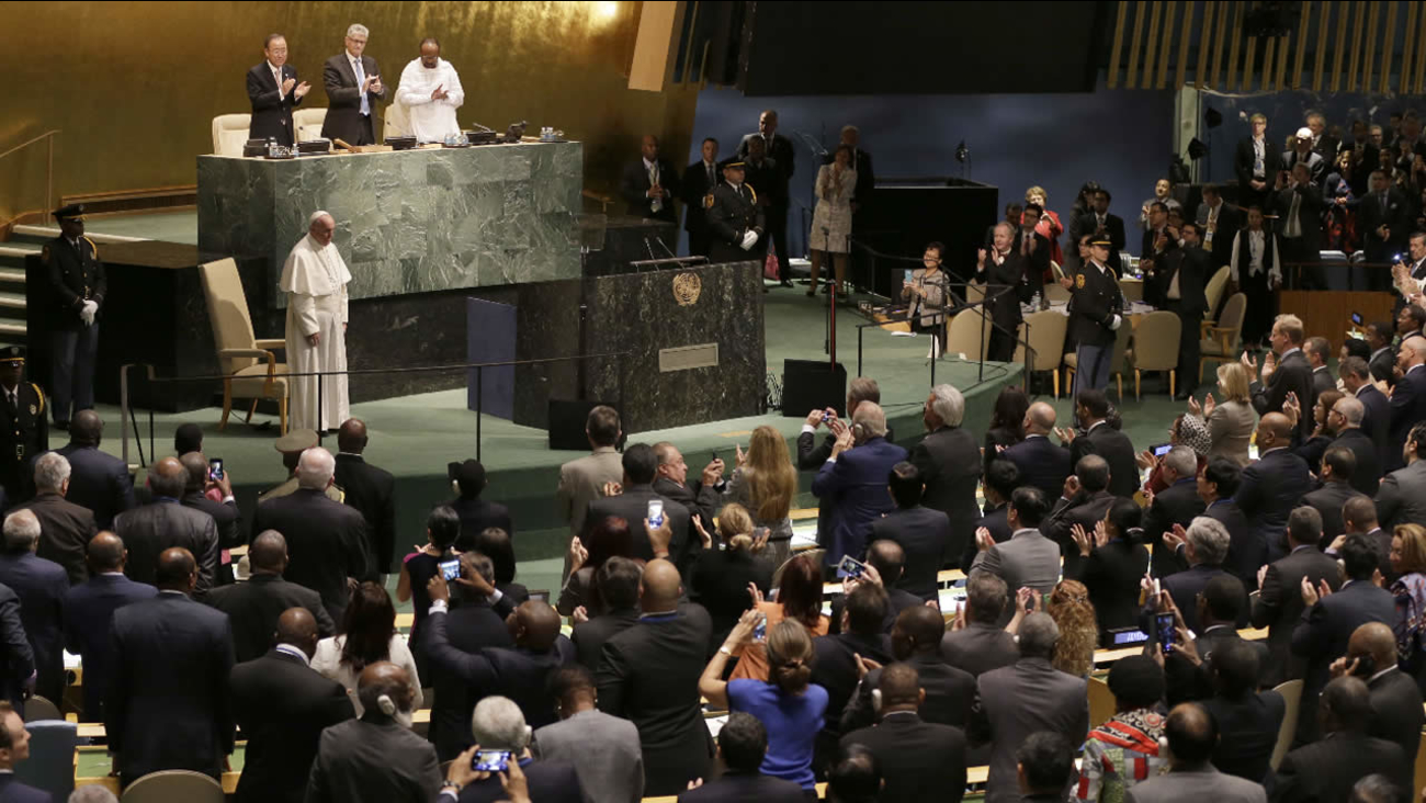 Pope Francis receives a standing ovation after addressing the 70th session of the United Nations General Assembly, Friday, Sept. 25, 2015 at United Nations headquarters.