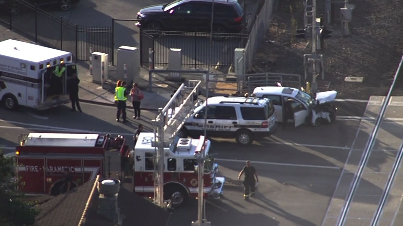 A passenger train has struck two vehicles on the tracks at Broadway Avenue in Burlingame, according to Caltrain officials.