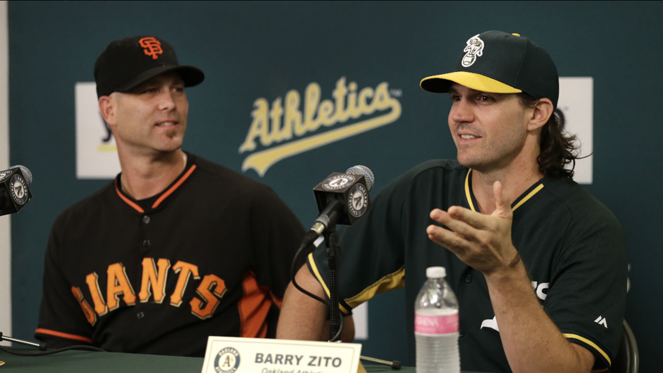 Oakland Athletics pitcher Barry Zito, right, gestures beside San Francisco Giants pitcher Tim Hudson during a media conference prior to their baseball game Friday, Sept. 25, 2015.