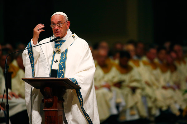 <div class='meta'><div class='origin-logo' data-origin='AP'></div><span class='caption-text' data-credit='Tony Gentile/Pool Photo via AP'>Pope Francis celebrates Mass at the Cathedral Basilica of Sts. Peter and Paul Saturday, Sept. 26, 2015, in Philadelphia.</span></div>