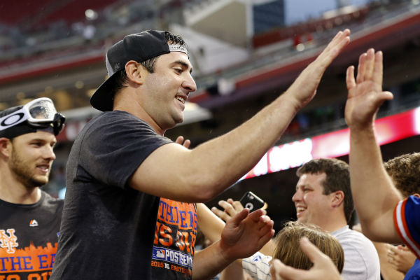 "<div class=""meta image-caption""><div class=""origin-logo origin-image none""><span>none</span></div><span class=""caption-text"">New York Mets' Matt Harvey celebrates with the fans after the clinching the NL East title in Cincinnati. (AP Photo/Aaron Doster) (AP Photo/ Aaron Doster)</span></div>"