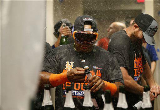 "<div class=""meta image-caption""><div class=""origin-logo origin-image none""><span>none</span></div><span class=""caption-text"">New York Mets' Yoenis Cespedes uncorks champagne as he celebrates with teammates in the clubhouse after clinching the NL East title. (AP Photo/Aaron Doster) (AP Photo/ Aaron Doster)</span></div>"