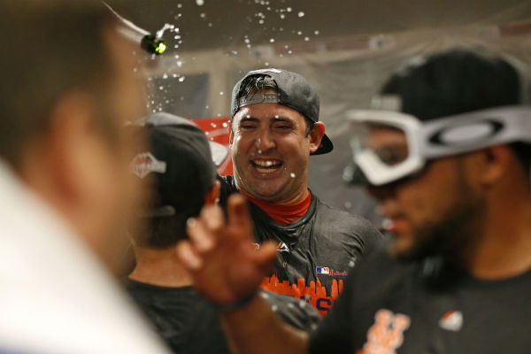 "<div class=""meta image-caption""><div class=""origin-logo origin-image none""><span>none</span></div><span class=""caption-text"">New York Mets pitcher Matt Harvey celebrates with teammates in the clubhouse after the clinching the NL East title. (AP Photo/Aaron Doster) (AP Photo/ Aaron Doster)</span></div>"