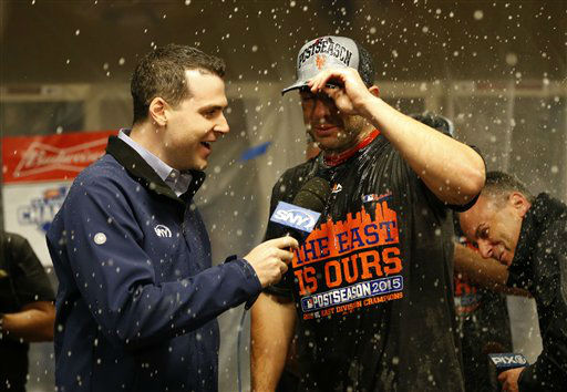 "<div class=""meta image-caption""><div class=""origin-logo origin-image none""><span>none</span></div><span class=""caption-text"">New York Mets' David Wright is interviewed in the clubhouse as they celebrate in the clubhouse after the clinching the NL East (AP Photo/Aaron Doster) (AP Photo/ Aaron Doster)</span></div>"