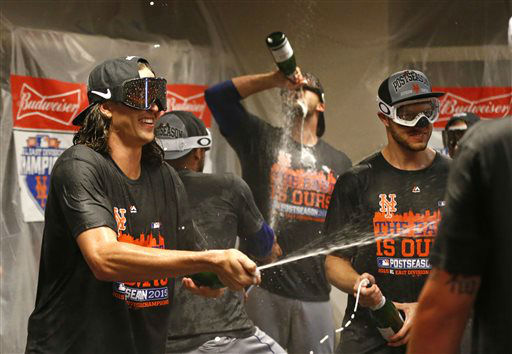 "<div class=""meta image-caption""><div class=""origin-logo origin-image none""><span>none</span></div><span class=""caption-text"">New York Mets' Jacob deGrom, left, celebrates in the clubhouse with teammates after clinching the NL East. (AP Photo/Aaron Doster) (AP Photo/ Aaron Doster)</span></div>"