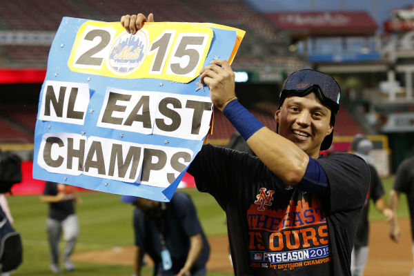 "<div class=""meta image-caption""><div class=""origin-logo origin-image none""><span>none</span></div><span class=""caption-text"">New York Mets' Wilmer Flores holds up a sign as he celebrates after clinching the NL East (AP Photo/Aaron Doster) (AP Photo/ Aaron Doster)</span></div>"