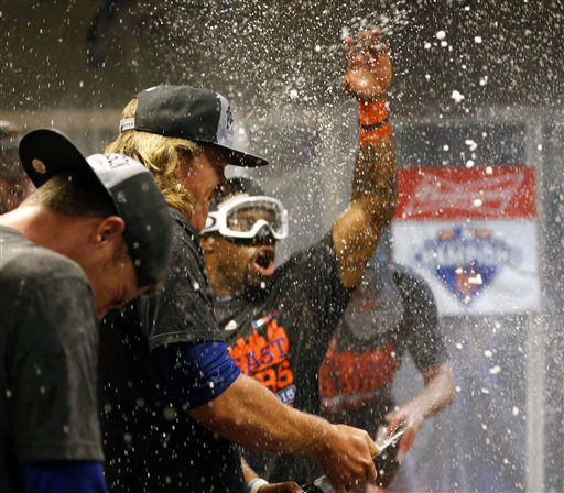 "<div class=""meta image-caption""><div class=""origin-logo origin-image none""><span>none</span></div><span class=""caption-text"">The New York Mets celebrate in the clubhouse after clinching the NL East title. (AP Photo/Aaron Doster) (AP Photo/ Aaron Doster)</span></div>"