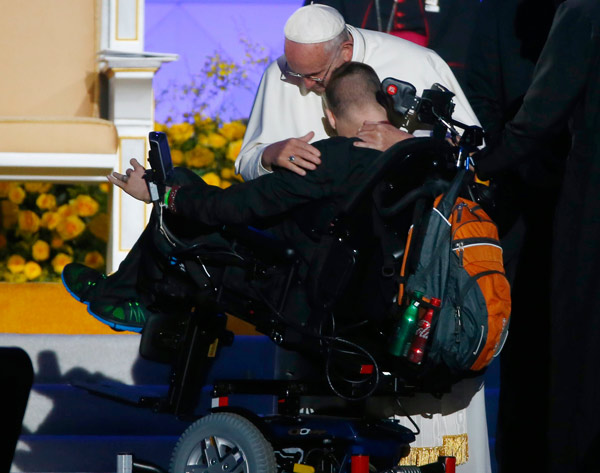 <div class='meta'><div class='origin-logo' data-origin='AP'></div><span class='caption-text' data-credit='Tony Gentile/Pool Photo via AP'>Pope Francis hugs an unidentified member of a Ukrainian family during the World Meeting of Families festival in Philadelphia, Saturday, Sept. 26, 2015.</span></div>
