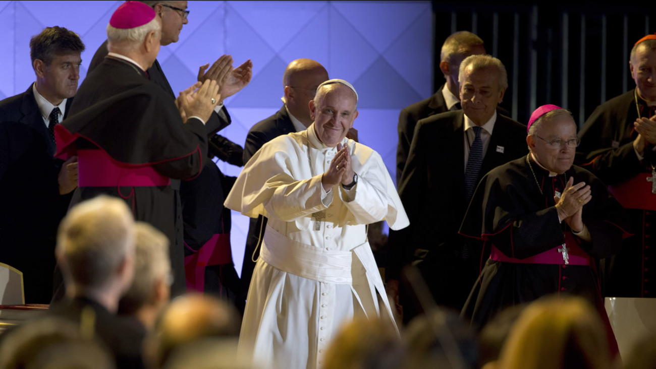 Pope Francis takes the stage at the World Meeting of Families festival on the Benjamin Franklin Parkway Saturday, Sept. 26, 2015, in Philadelphia.