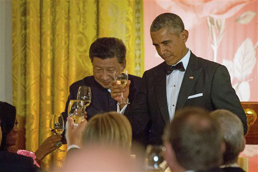 "<div class=""meta image-caption""><div class=""origin-logo origin-image none""><span>none</span></div><span class=""caption-text"">Chinese President Xi Jinping and President Barack Obama toast. (AP Photo/ Andrew Harnik)</span></div>"