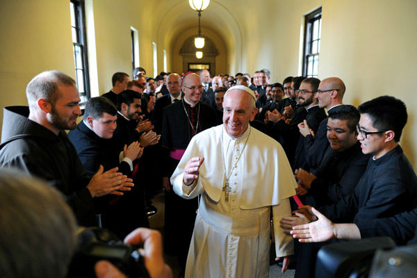 "<div class=""meta image-caption""><div class=""origin-logo origin-image none""><span>none</span></div><span class=""caption-text"">Pope Francis greets seminarians as he walks the loggia to his address to the Bishops at St. Martin of Tours Chapel at St.Charles Borromeo Seminary. (Photo/Tom Gralish)</span></div>"
