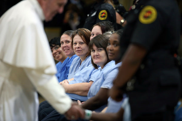 "<div class=""meta image-caption""><div class=""origin-logo origin-image none""><span>none</span></div><span class=""caption-text"">Pope Francis greets female inmates during his visit to the Curran Fromhold Correctional Facility in Philadelphia, Sunday, Sept. 27, 2015. (Photo/David Maialetti)</span></div>"