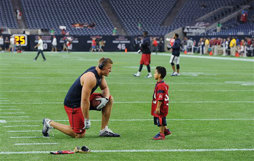 "<div class=""meta image-caption""><div class=""origin-logo origin-image none""><span>none</span></div><span class=""caption-text"">JJ Watt before the game with a young fan. (AP photo)</span></div>"