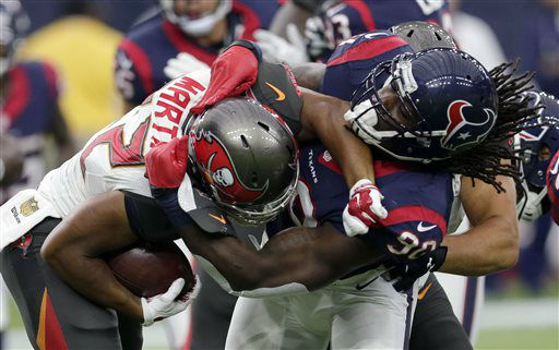 "<div class=""meta image-caption""><div class=""origin-logo origin-image none""><span>none</span></div><span class=""caption-text"">Tampa Bay Buccaneers' Doug Martin (22) is wrapped up by Houston Texans' Jadeveon Clowney (90) (AP Photo/ David J. Phillip)</span></div>"