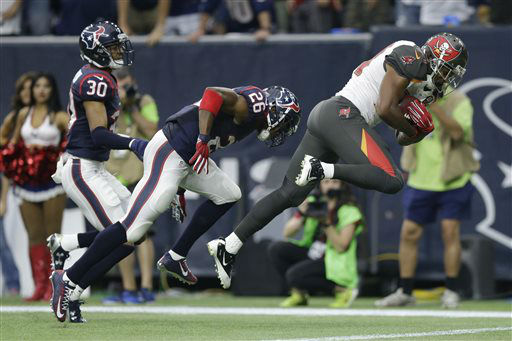 "<div class=""meta image-caption""><div class=""origin-logo origin-image none""><span>none</span></div><span class=""caption-text"">Tampa Bay Buccaneers' Charles Sims, right, dives past Houston Texans' Rahim Moore (AP Photo/ Patric Schneider)</span></div>"