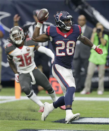 "<div class=""meta image-caption""><div class=""origin-logo origin-image none""><span>none</span></div><span class=""caption-text"">Houston Texans' Alfred Blue (28) celebrates after he scored a touchdown (AP Photo/ David J. Phillip)</span></div>"