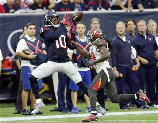 "<div class=""meta image-caption""><div class=""origin-logo origin-image none""><span>none</span></div><span class=""caption-text"">Houston Texans' DeAndre Hopkins (10) misses a catch as Tampa Bay Buccaneers' Tim Jennings (28) (AP Photo/ David J. Phillip)</span></div>"