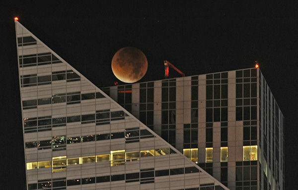 """<div class=""""meta image-caption""""><div class=""""origin-logo origin-image none""""><span>none</span></div><span class=""""caption-text"""">The supermoon is seen over Warsaw, Poland, overnight on Sept. 27, the night of a lunar eclipse. (Photo/AP)</span></div>"""