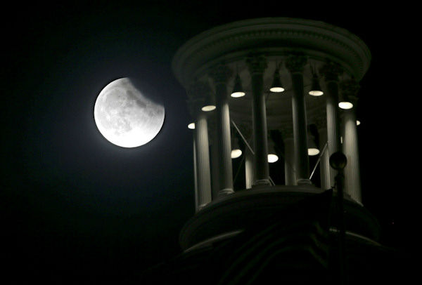"<div class=""meta image-caption""><div class=""origin-logo origin-image none""><span>none</span></div><span class=""caption-text"">The supermoon is seen over  Sacramento, Calif., overnight on Sept. 27, the night of a lunar eclipse. (Photo/AP)</span></div>"