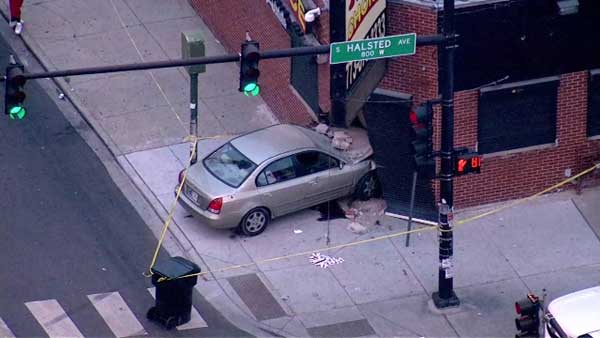 A car crashed into a building at the corner of West 79th and South Halsted streets Chicago's Gresham neighborhood.