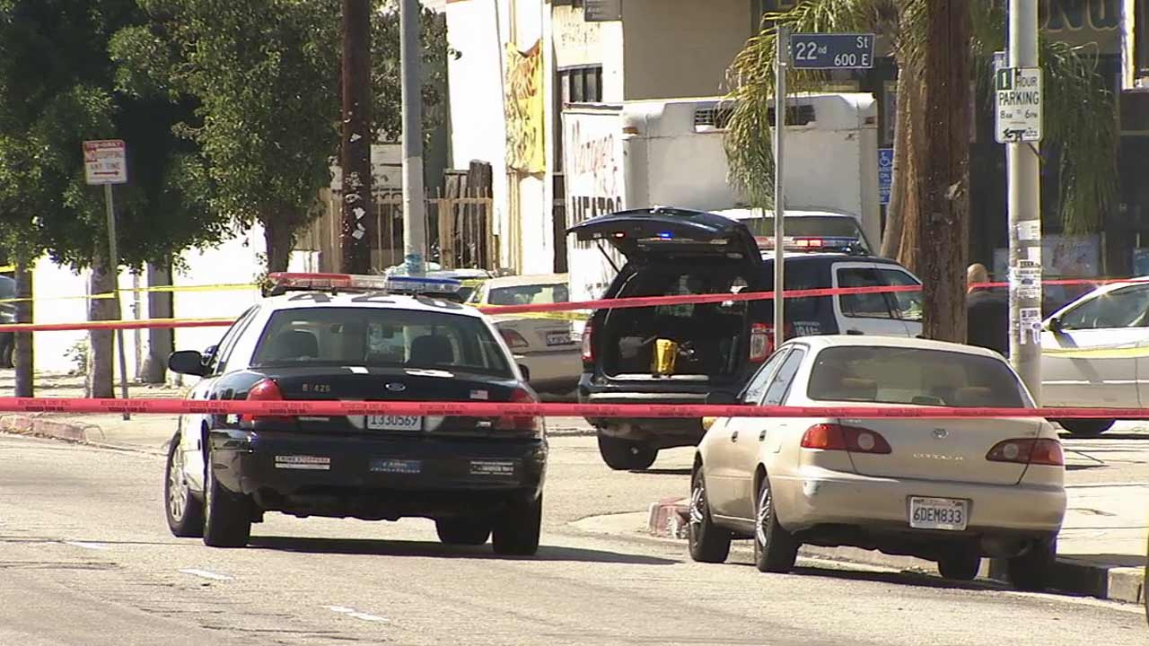 Police investigate an officer-involved shooting near East 22nd and South San Pedro streets in South Los Angeles on Sunday, Sept. 27, 2015.