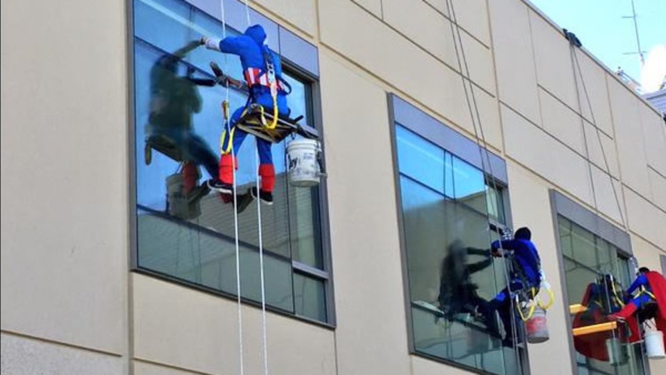 Window washers dressed as superheroes surprise sick children at UCSF Benioff Children's Hospital in San Francisco on Monday, September 28, 2015.
