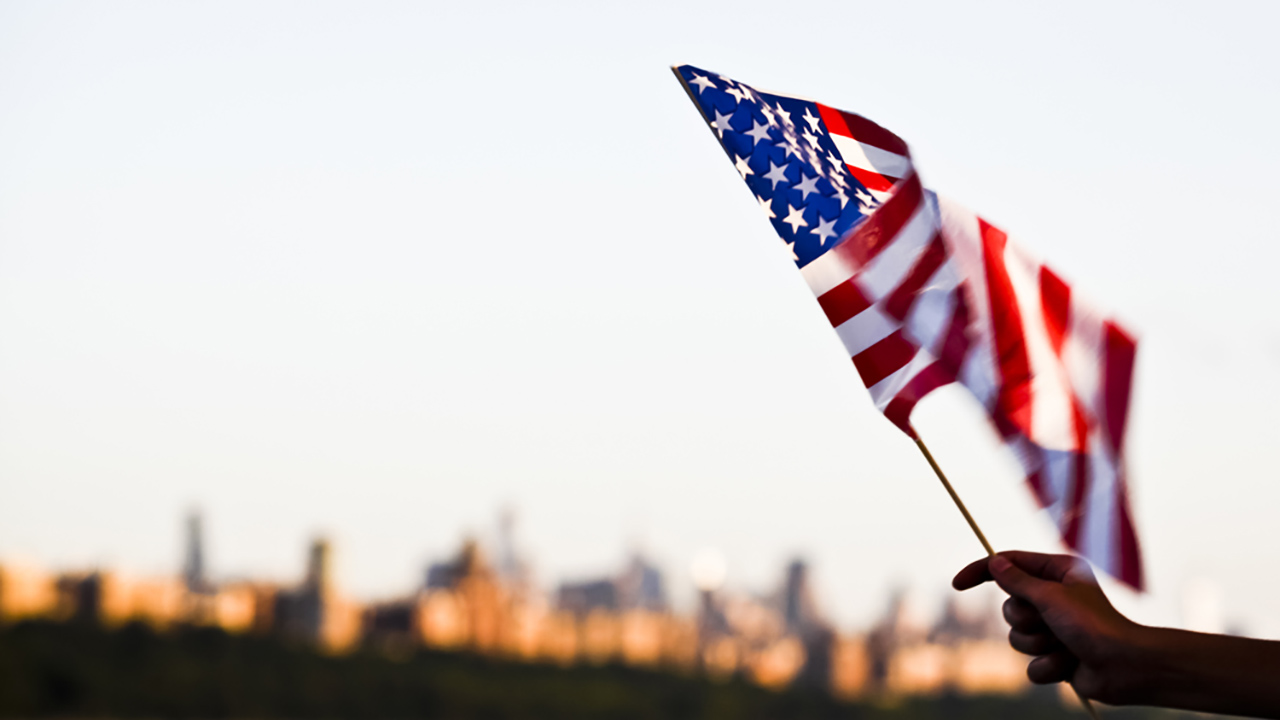 American flag during Independence Day on the Hudson River with a view at Manhattan.