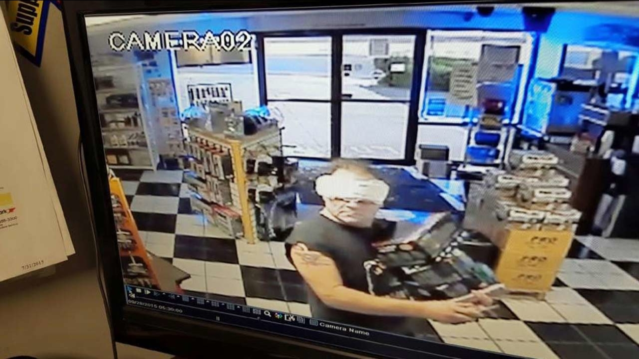 Surveillance video shows Gary Victor, accused of burglarizing a Battery Mart in Apple Valley, wearing a feminine hygiene product on his face.