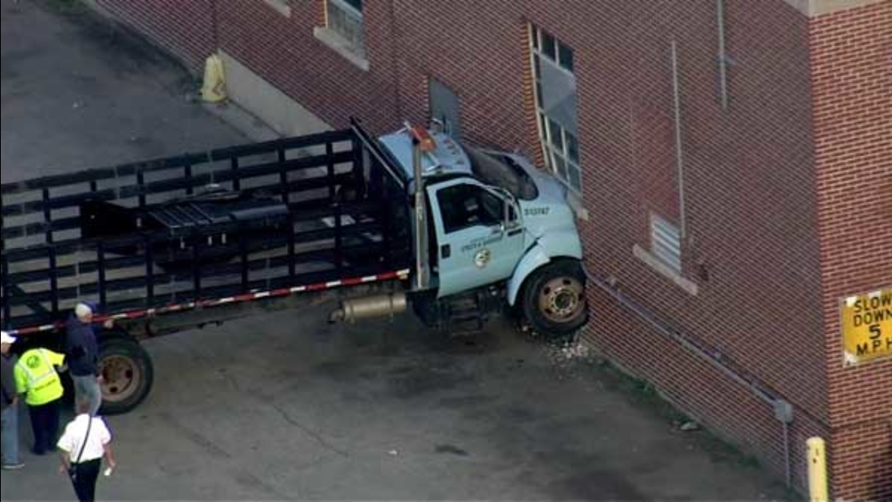 A Streets and Sanitation truck crashed into one of the department's buildings on Chicago's Southwest Side.