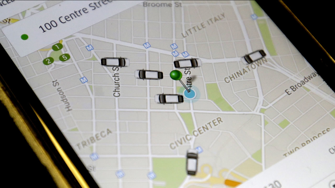 FILE - In this Wednesday, March 18, 2015, file photo, the Uber app displays on a smart phone cars available for a pick up in downtown Manhattan.(AP Photo/Mary Altaffer, File)