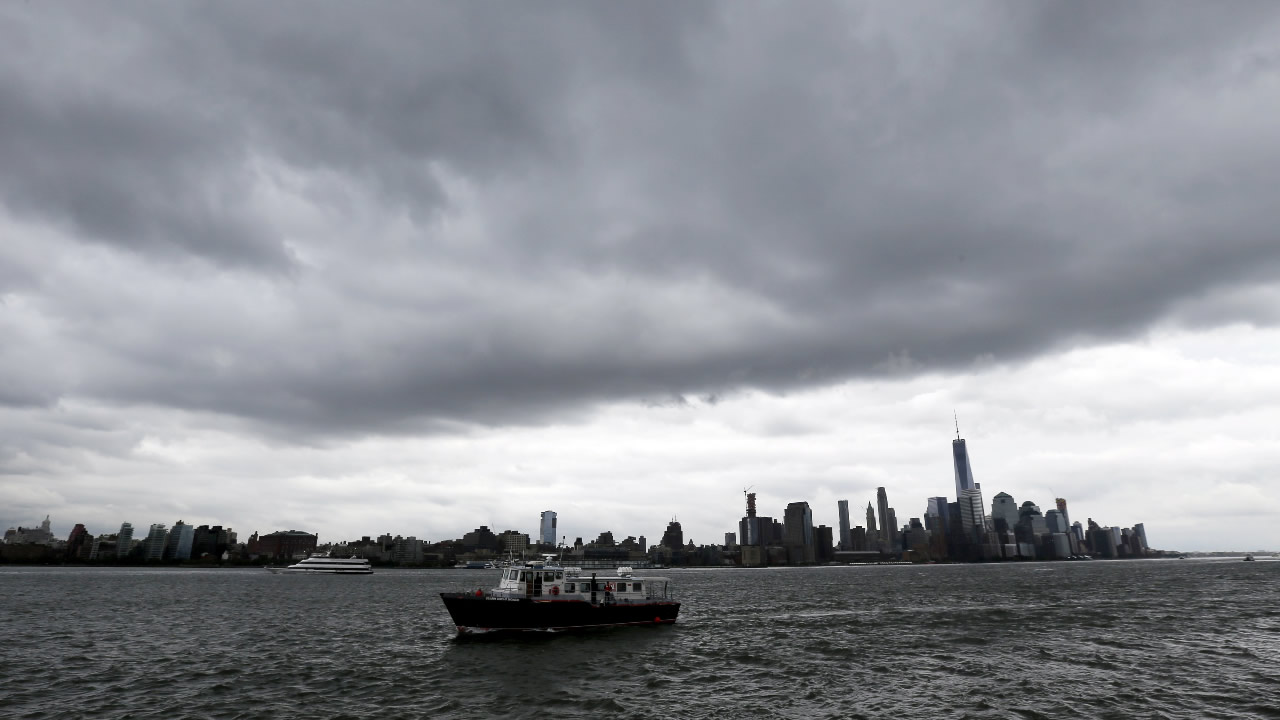 A boat passes Pier A Park on the Hudson River with the New York skyline in the background on Wednesday, Sept. 30, 2015, in Hoboken, N.J.
