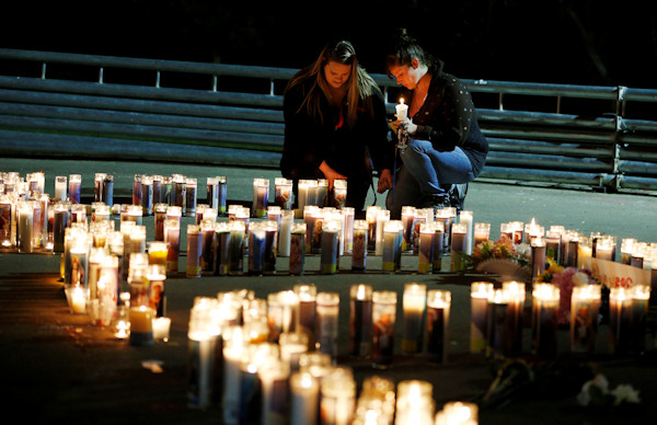 "<div class=""meta image-caption""><div class=""origin-logo origin-image none""><span>none</span></div><span class=""caption-text"">Meriah Calvert, left, of Roseburg, Ore., and an unidentified woman pray after a candlelight vigil for victims of a shooting at Umpqua Community College on Thursday. (AP Photo/John Locher)</span></div>"