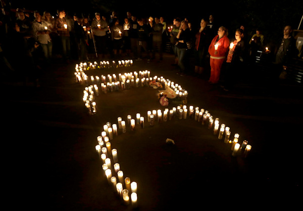"<div class=""meta image-caption""><div class=""origin-logo origin-image none""><span>none</span></div><span class=""caption-text"">Candles spelling UCC for Umpqua Community College, are displayed at a candlelight vigil for those killed during a fatal shooting at the school Thursday. (AP Photo/Rich Pedroncelli)</span></div>"