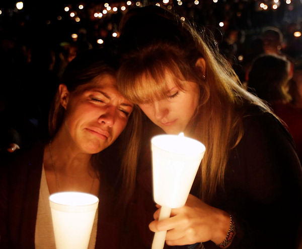 "<div class=""meta image-caption""><div class=""origin-logo origin-image none""><span>none</span></div><span class=""caption-text"">Kristen Sterner, left, and Carrissa Welding, both students at Umpqua Community College, embrace each other during a candlelight vigil for those killed during a shooting Thursday. (AP Photo/Rich Pedroncelli)</span></div>"