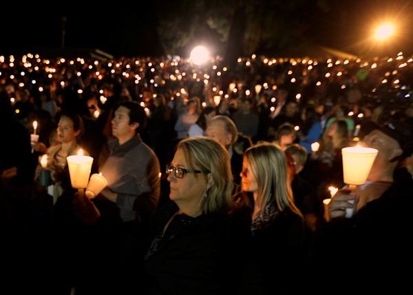 "<div class=""meta image-caption""><div class=""origin-logo origin-image none""><span>none</span></div><span class=""caption-text"">Community members gather for a candlelight vigil for those killed in a shooting at Umpqua Community College in Roseburg, Ore., Thursday. (AP Photo/Rich Pedroncelli)</span></div>"
