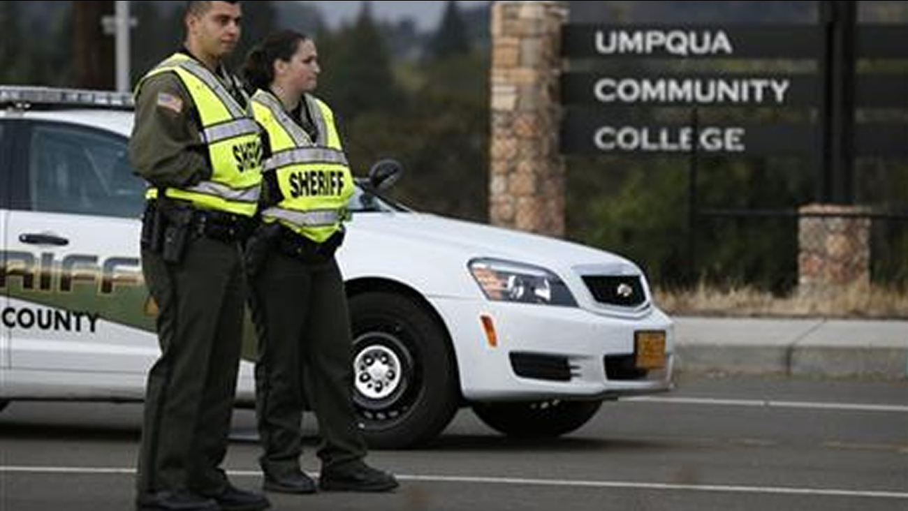 Sheriff's deputies man a roadblock on the road leading to Umpqua Community College Saturday, Oct. 3, 2015, in Roseburg, Ore.