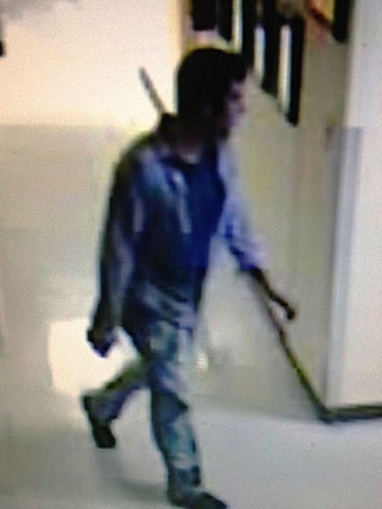 """<div class=""""meta image-caption""""><div class=""""origin-logo origin-image none""""><span>none</span></div><span class=""""caption-text"""">Raleigh police released this surveillance photo of a suspect in the break-in (Photo/News & Observer)</span></div>"""