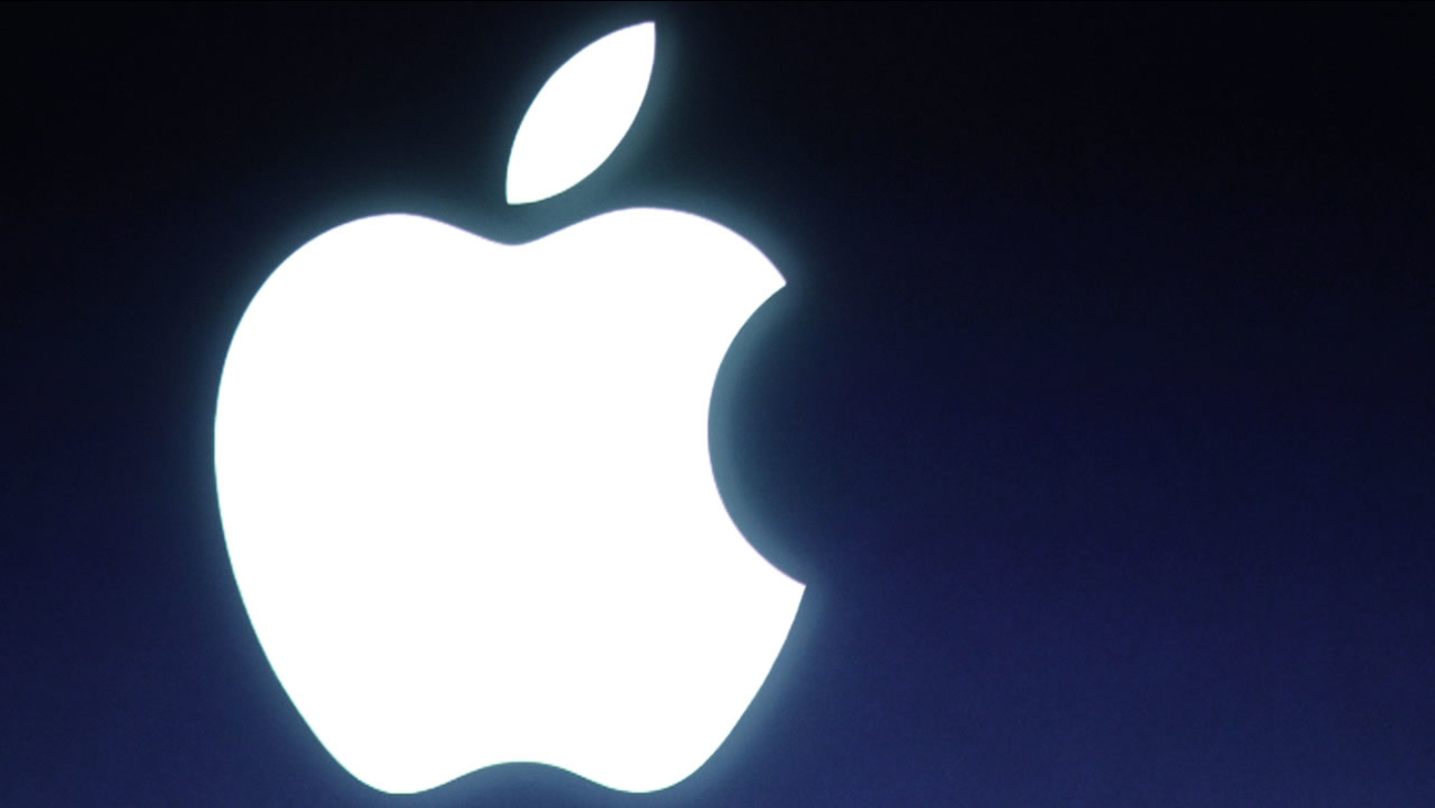 In this Tuesday, Oct. 4, 2011 file photo and Apple logo is seen during an announcement at Apple headquarters in Cupertino, Calif..