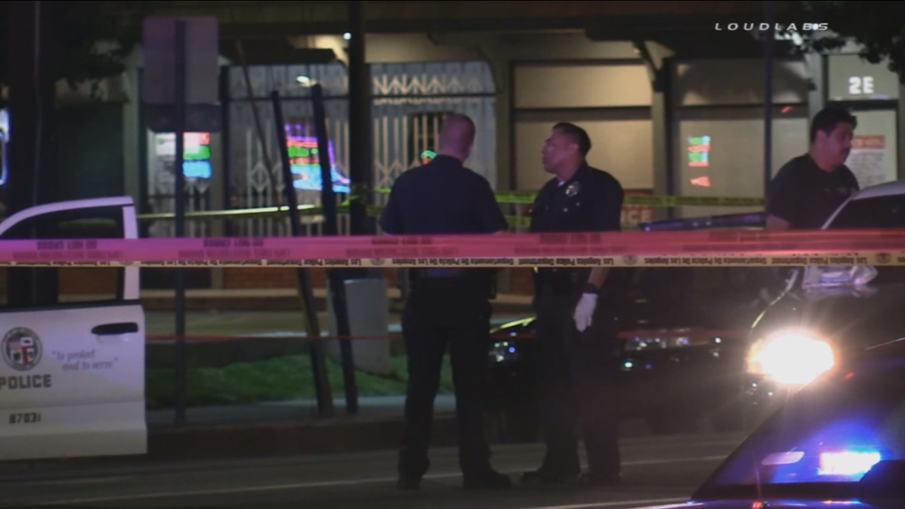 Authorities investigate a deadly officer-involved shooting near Victory and Sepulveda boulevards in Van Nuys on Saturday, Oct. 3, 2015.