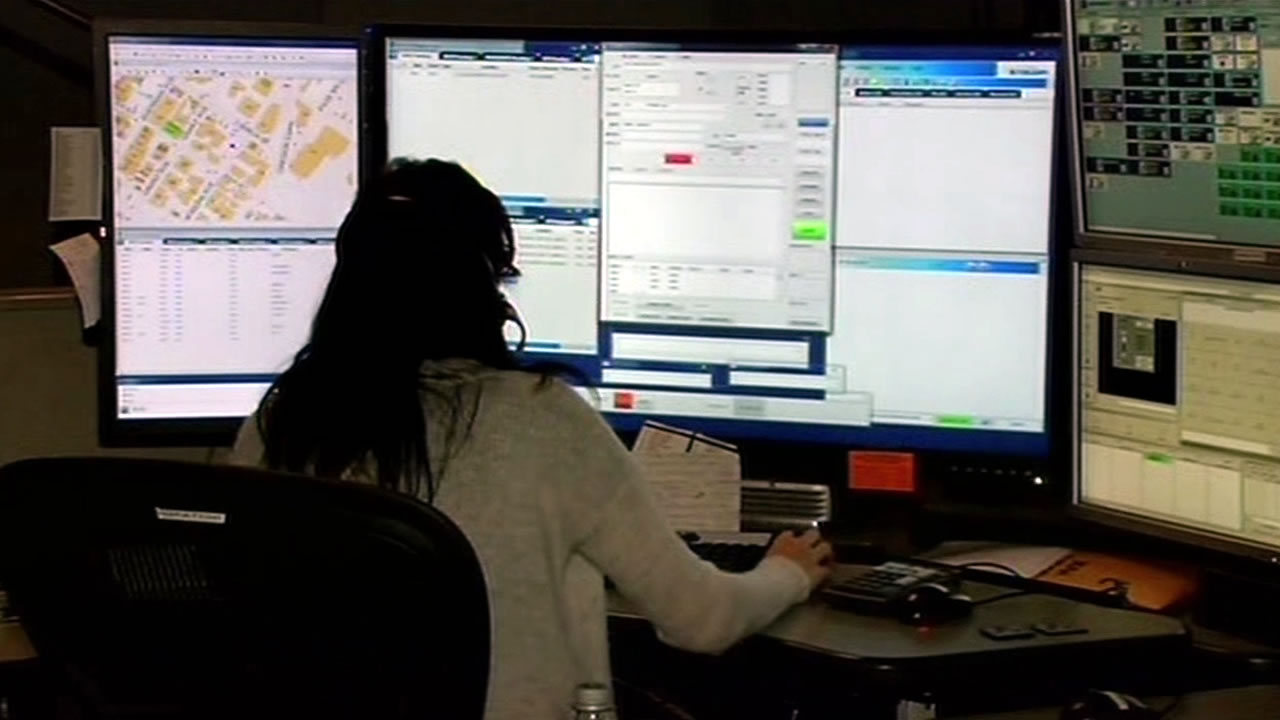 FILE - A woman is seen taking calls at an emergency call center in this undated image.