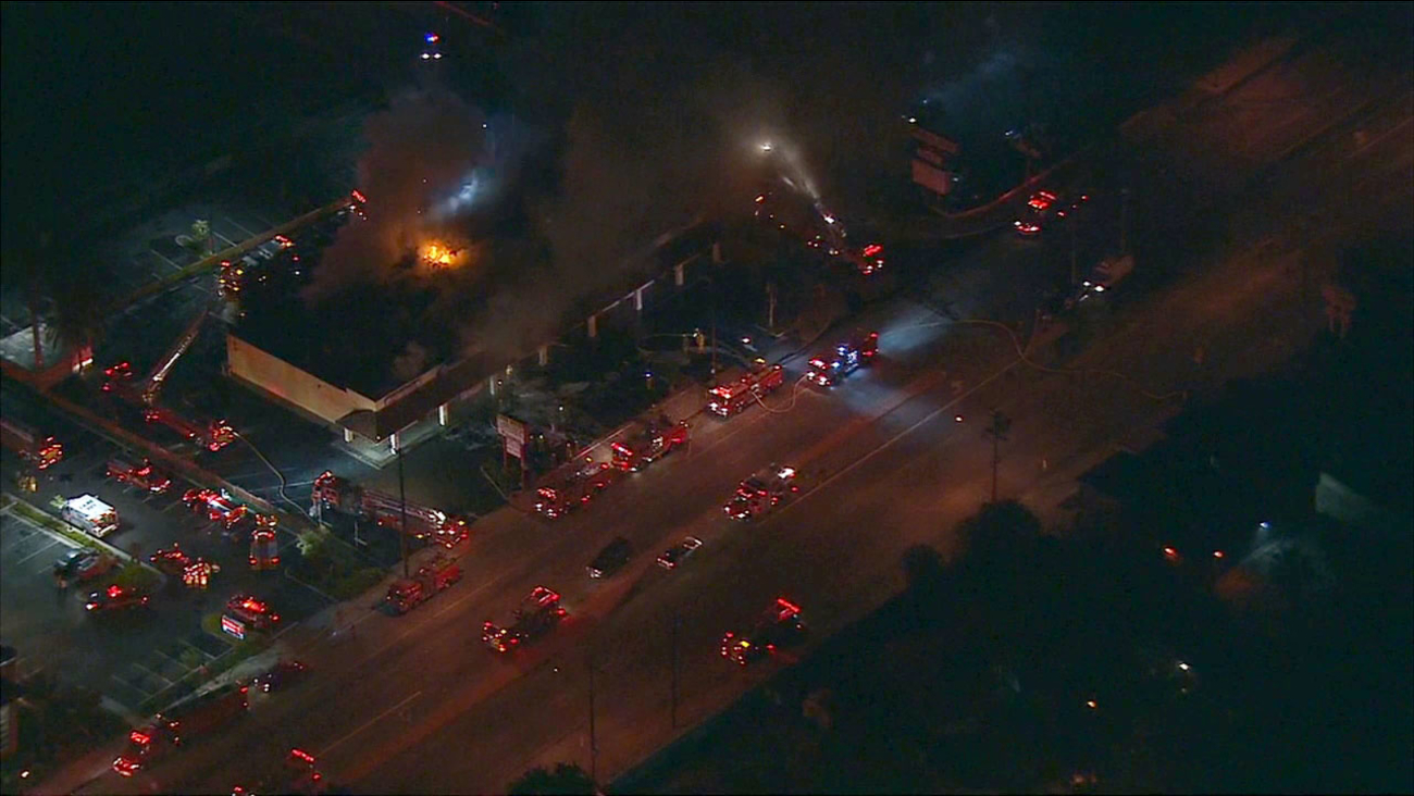 Firefighters battled a second-alarm fire at a strip mall in Pico Rivera on Tuesday, Oct. 6, 2015.