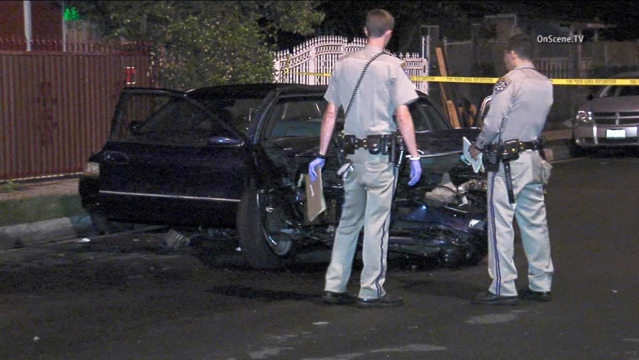 Authorities investigate a car-to-car shooting near South Compton Avenue and East 118th Avenue in the Willowbrook area on Monday, Oct. 5, 2015.