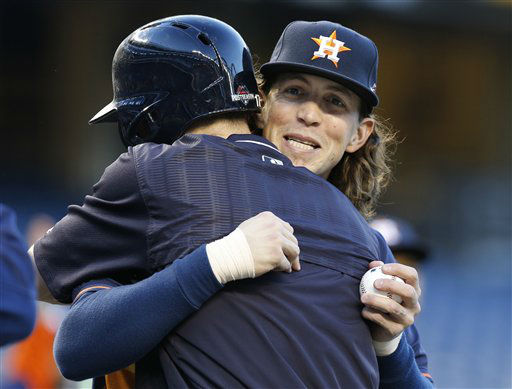 "<div class=""meta image-caption""><div class=""origin-logo origin-image none""><span>none</span></div><span class=""caption-text"">Houston Astros Colby Rasmus embraces New York Yankees Brendan Ryan on the field before their teams faced each other (AP Photo/ Kathy Willens)</span></div>"