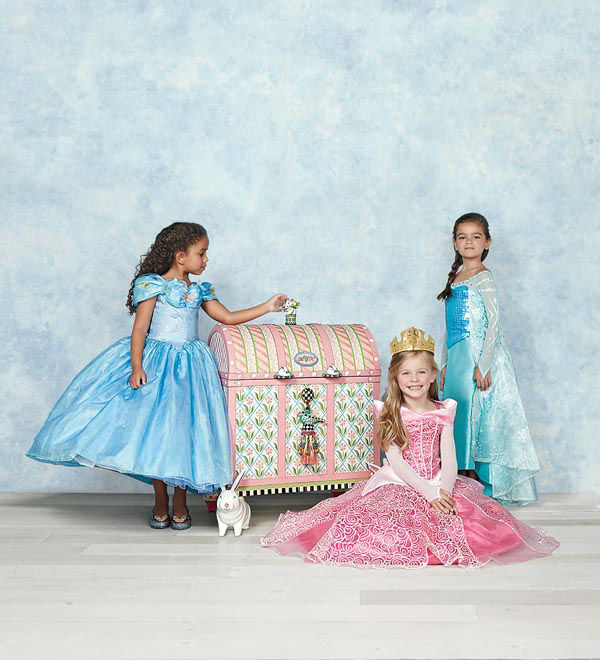 """<div class=""""meta image-caption""""><div class=""""origin-logo origin-image none""""><span>none</span></div><span class=""""caption-text"""">Costumes in the girl's version of the MacKenzie-Childs trunk includes Disney favorites Ultimate Collection Elsa, Ultimate Collection Aurora and a Cinderella Ball Gown. (Photo/Neiman Marcus)</span></div>"""