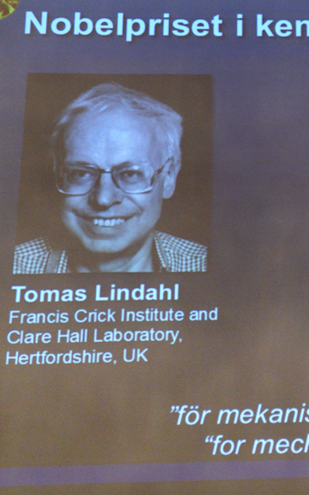 "<div class=""meta image-caption""><div class=""origin-logo origin-image none""><span>none</span></div><span class=""caption-text"">Tomas Lindahl, the Emeritus director of Cancer Research UK at Clare Hall Laboratory in England, is shown during the announcement of the Nobel Prize in chemistry. (AP Photo)</span></div>"