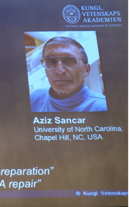 "<div class=""meta image-caption""><div class=""origin-logo origin-image none""><span>none</span></div><span class=""caption-text"">Aziz Sancar, professor of biochemistry and biophysics at the University of North Carolina School of Medicine, is shown during the announcement of the Nobel Prize in chemistry. (AP Photo)</span></div>"