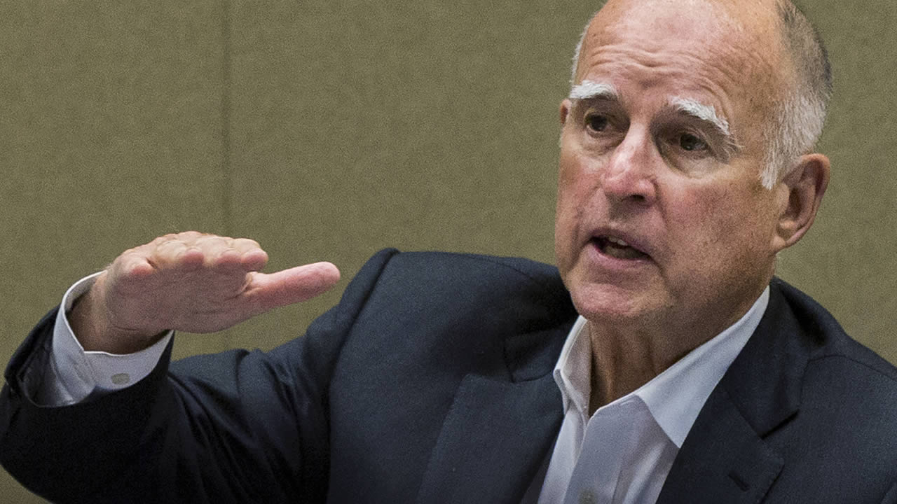 FILE - In this June 9, 2015, file photo, California Gov. Jerry Brown meets with board members of the Metropolitan Water District of Southern California in Los Angeles.