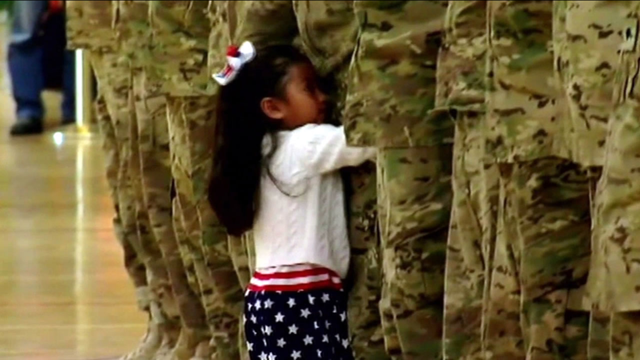 FILE - A young girl is seen hugging her father during a US Army homecoming ceremony in this undated image.